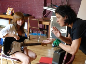 Jill teaching guitar